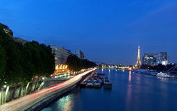 Paris - the Eiffel Tower seen from Pont de Garigliano at the blue hour. The Eiffel Tower and the Skyscrapers on Quai Andre Citroen, seen at the blue hour from royalty free stock images