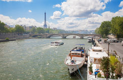 Paris - Eiffel tower and ships on Seine Stock Photos