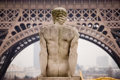 Paris Eiffel Tower with statue. The statue seems to admire the Eiffel Tower on the Trocadero. We see the Tour Montparnasse in the background, left Stock Images