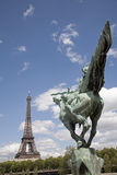 Paris - Eiffel tower and statue of Joan of Arc Stock Images
