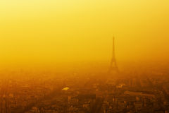 Paris - Eiffel Tower at sunset. Paris, France at sunset with Eiffel Tower overtopping the city. Picture was taken at low visibility due to massive smog Royalty Free Stock Photos