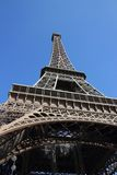 Paris_Eiffel tower under blue sky. The Eiffel tower of Paris seen from below. The sky is blue Royalty Free Stock Photo