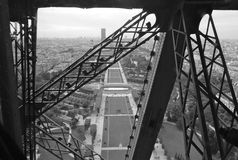 Paris Eiffel Tower View Through Girders Black and White. View of Paris from Eiffel Tower. Shot in black and white from the moving elevator as it shot upward Royalty Free Stock Photography
