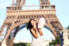 Paris Eiffel Tower woman. Smiling happy and cheerful eating cotton candy in front of Eiffel Tower in Paris, France. Cute Asian / Caucasian girl Stock Image