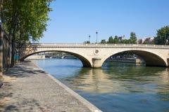 Paris, empty Seine river docks and bridge in a sunny day in France. Paris, empty Seine river docks and bridge in a sunny summer day in France royalty free stock image