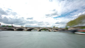 Paris. The excursion motor ship floats down the. River Seine in the cloudy spring day timelapse 4K part 3 stock footage