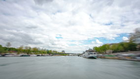 Paris. The excursion motor ship floats down the. River Seine in the cloudy spring day timelapse 4K part 6 stock video