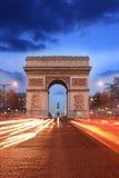 Paris, Famous Arc de Triumph at evening , France. Famous Arc de Triumph with traffic jam in Paris, France Royalty Free Stock Photography