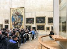Group of tourist crowded in front of the Gioconda painting. Paris - february 23, 2018: group of tourist crowded in front of the Gioconda painting in a beautiful Royalty Free Stock Photos