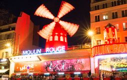 The Moulin Rouge , Paris, France. It is a famous cabaret built in 1889, locating in the Paris red-light district of. PARIS - February 17, 2018 : The Moulin Rouge stock photo