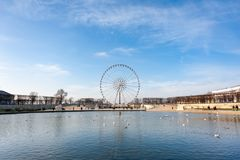 Paris ferris-wheel against blue sky from the Tuileries park with Stock Photo