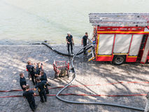 Paris fire brigades fill tanks from Seine River Royalty Free Stock Image