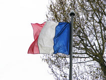 Paris flag pole with flag flapping in the wind Royalty Free Stock Image