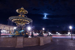 Paris Fontain Concorde Square. Landmark and touristic spot: fontain on the Concorde square Place de la Concorde in Paris, France, at night with cloudy sky and Stock Photography