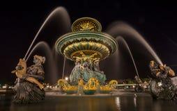 Paris fountain at night Stock Photo