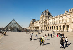 PARIS, FRANCE – MARCH 06, 2014: Tourists in the Louvre's centr Stock Images