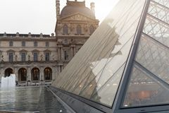 PARIS, FRANCE. 01 June 2018: Louvre Museum square with summer sunset. The old renaissance building is enlightened by the sun and t Stock Image