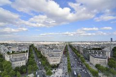 Paris, France . Aerial view on the Eiffel Tower, Arc de Triomphe, Les Invalides etc. Arc de Triomphe, Paris with French flag Stock Image