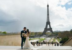 Free Paris, France - April 3, 2019: Newly Married Asian Couple Posing For Picture In Paris, Trocadero Stock Photo - 144997500