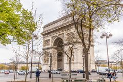 Paris, France - APRIL 9, 2019: Champs-Elysees and Arc de Triomphe on a cloudy day, Paris. France royalty free stock photo