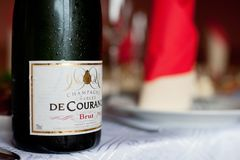 PARIS, FRANCE - APRIL 13, 2012: Cold and Wet Bottle of Charles de Courance Brut Champagne From France on the Table. royalty free stock images
