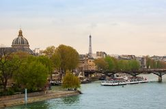 Eiffel Tower and tour boats called bateaux mouches Stock Photo