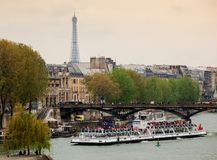 Eiffel Tower and tour boats called bateaux mouches Royalty Free Stock Photography