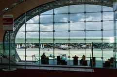 Paris, France, April 1 2017: Looking out a large ellipsoid window at Charles De Gaulle airport Royalty Free Stock Images