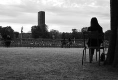 Luxembourg Gardens in black and white. Paris, France - April 08, 2019. Luxembourg Gardens in Paris. In the background the Montparnasse tower stock image