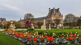 Marvelous spring Tuileries garden and view at the Louvre Palace Paris France. April 2019 stock images