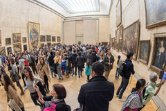 PARIS, FRANCE - APRIL 30, 2016 - Mona Lisa painting Louvre hall crowded of tourist Royalty Free Stock Photo