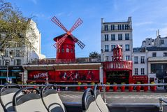 Paris / France - April 06 2019: Moulin Rouge is a famous cabaret in Paris France. View from the tourist bus stock image