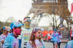 PARIS, FRANCE - APRIL 17: Participants of The Color Run near the Eiffel tower on April 17, 2016 in Paris, France. The Color Run is Stock Photography