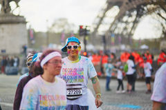 PARIS, FRANCE - APRIL 17: Participants of The Color Run near the Eiffel tower on April 17, 2016 in Paris, France. The Color Run is Royalty Free Stock Photo