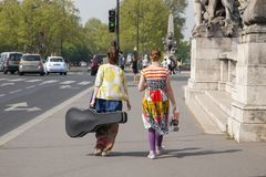 Paris, France - April 11, 2011: Pretty Female Musicians Walking Down stock photography