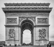 Paris France - April 30th 2013 Tourists at the worlds largest ro. Undabout, the Arc De Triomphe in Paris, France Stock Images