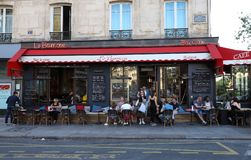 The traditional french cafe Barricou located on Beaumarchais boulevard , Paris, France. stock photos