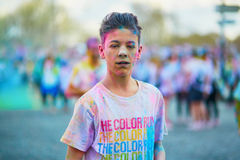PARIS, FRANCE - APRIL 17: Young participant of The Color Run on April 17, 2016 in Paris, France. The Color Run is a worldwide host Royalty Free Stock Photos