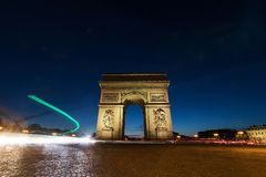 Traffic light trails at Arc De Triomphe in Paris, France at nigh. Paris France Arc De Triomphe at night Royalty Free Stock Photo