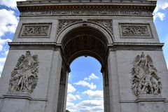 Paris, France. Arch of Triumph closeup. Blue sky with clouds. stock photography