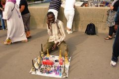 Paris, France August 18 2014. African immigrant offering souveni Stock Photography