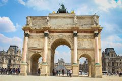 Paris, France - August 19, 2017: Arc de Triomphe at Place du Carrousel in Paris France on bright sunny summer day. Paris, France - August 19, 2017: Arc de Royalty Free Stock Photography