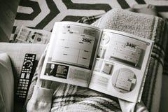 Woman reading Ikea catalogue Royalty Free Stock Photography