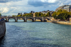 PARIS, FRANCE - AUGUST 30, 2015: The bridge Pont au Change over river Seine in Paris, France. Stock Image