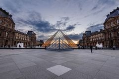 Grand Louvre Pyramid and Palace at Dusk Royalty Free Stock Images