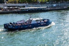 PARIS, FRANCE - AUGUST 28, 2015: Modern transport boat on Siena in summertime. Paris - France Royalty Free Stock Photo