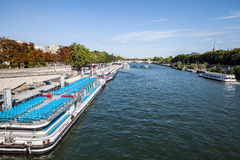 PARIS, FRANCE - AUGUST 28, 2015: Modern transport boat on Siena in summertime. Paris - France Royalty Free Stock Photos