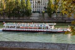 PARIS, FRANCE - AUGUST 28, 2015: Modern transport boat on Siena in summertime. Paris - France Stock Photos