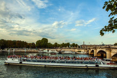 PARIS, FRANCE - AUGUST 28, 2015: Modern transport boat on Siena in summertime. Paris - France Stock Photography