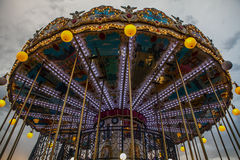 PARIS, FRANCE - AUGUST 30, 2015: Old French carousel in a holiday park at night summer time. PARIS, FRANCE - AUGUST 30, 2015: Old French carousel in a holiday royalty free stock photography